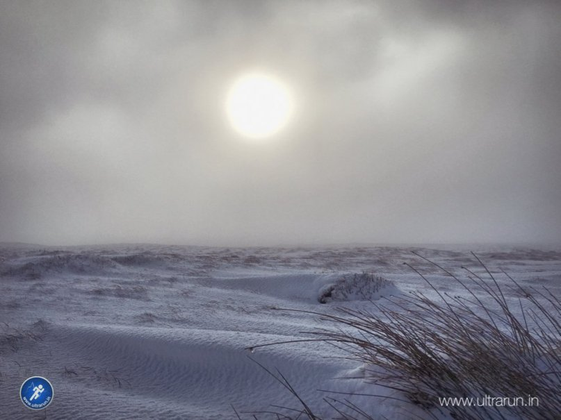 The sun trying to burn the cloud off over Bleaklow