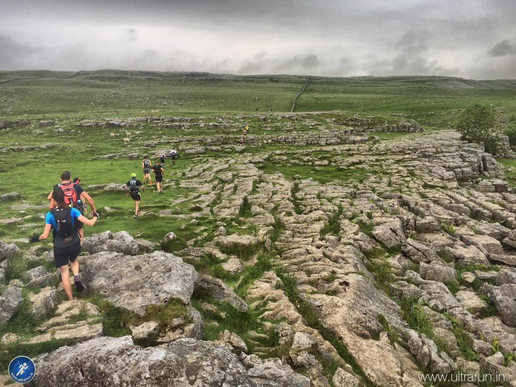 Dancing across the limestone pavement above Malham Cove