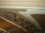 Paint and gold-copper leaf begins to go on medallion lights