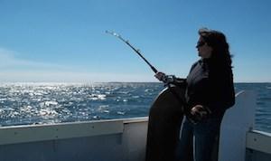 Participating fishermen jigging for the sentinel survey