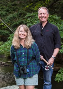 Paul Doiron and Kristen Lindquist on rock in creek.