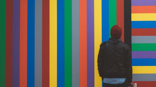 gallery visitor standing in front of Sol Lewitt wall drawing