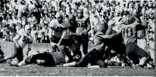Bernie Faloney dives through Clemson defenders on an option play