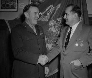 John Lanigan (left) shaking Senator Joseph McCarthy's hand, 1952. Photo Credit: Corbis Images