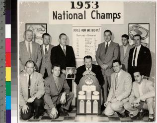 Coaching staff with the national championship trophy