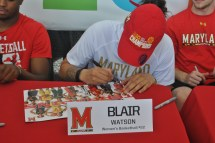 Freshman Blair Watson of the women's basketball team signs autographs for fans.