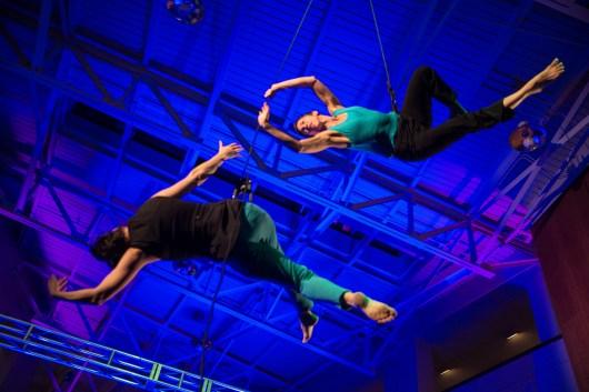 Bandaloop perfromers Damara Vita Ganley and Rachael Lincoln tumble and dance through the air inside the grand pavillion at The Clarice.