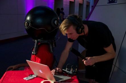 Ben Graney Green, junior aerospace engineering major, remixes live sound for the person inside the Soundware helmet. (Gabe Fernandez/Blog Photographer)