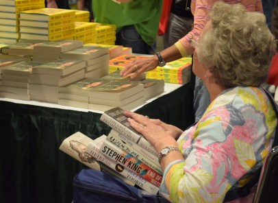 """Martha Gay, 70, travelled from her home in Downingtown, Pa. to attend the National Book Festival in D.C. Saturday Sept. 24, 2016 for a second year. Gay hand-selected a pile of six books to purchase, however assured that this haul was """"not as many as last year."""" (Jordan Stovka/Bloc Reporter)"""