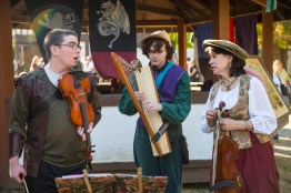 (from left to right) Paul Wells, Tadgh McDonagh and Cathy Palmer play instruments at the 40th annual Maryland Rennaisance Festival. (Josh Loock/Bloc Photographer)