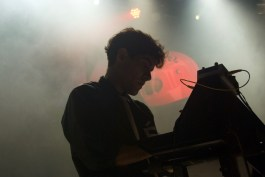 Neon Indian's Alan Palomo mixes and synthesizes chill-wave rhythms before an ecstatic, dancing crowd at 9:30 Club Friday, Oct. 7, 2016. (Jordan Stovka/Bloc Reporter)