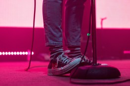 Singer Paul Klein rests his foot on the mic stand while performing at the 9:30 Club. (Casey Tomchek/Freelance Photographer)