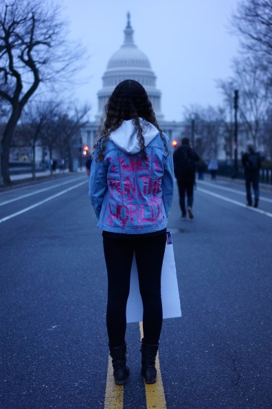 "Christiana Patch, a senior from River Hill High School, stands with her back to the camera to proudly display her jacket which reads ""WHO RUN THE WORLD?"" (Heather Kim/Bloc Photographer)"