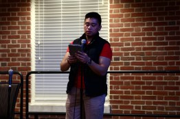 Gabriel Vallangca, a junior Computer Science major and Asian American Studies minor, shares a poem about his immigration experience. (Heather Kim/Bloc Photographer)
