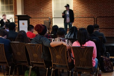 Audience members listening intently as a student performs his piece. (Heather Kim/Bloc Photographer)