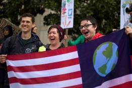 Marchers pose with an Earth Day flag in honor of Earth Day. (Julia Lerner/The Writer's Bloc).