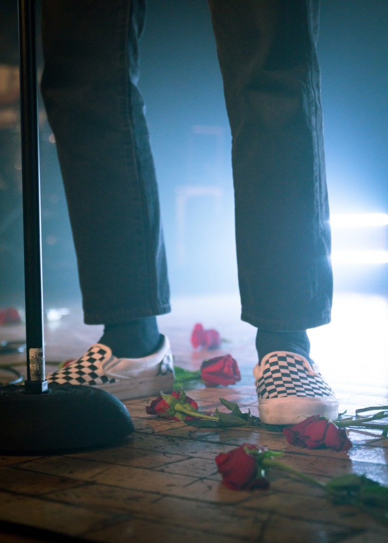 Roses sit at Paul Klein's feet during a performance at the Baltimore Soundstage on May 14, 2017. (Casey Tomchek/Freelance Photographer)