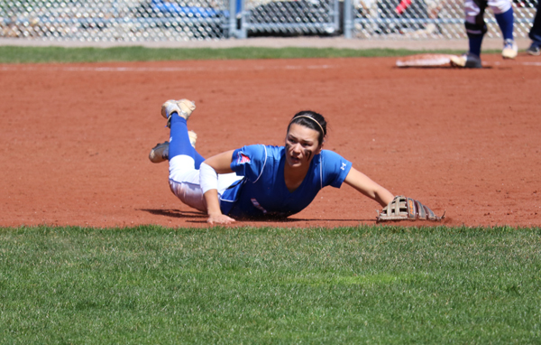 Junior shortstop Alisha Welch makes a diving attempt at a line drive in game one. Welch went 1-5 at the plate with two walks and a strikeout Saturday.