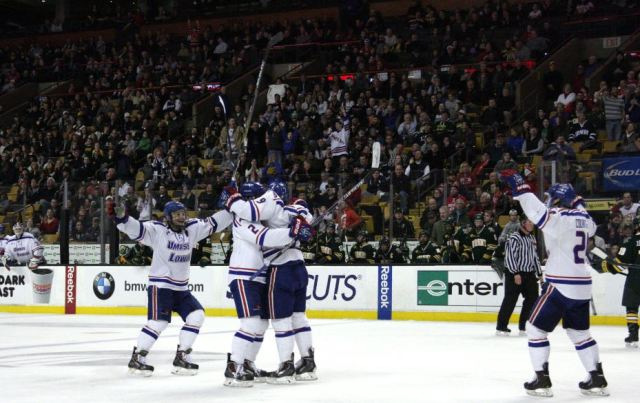 The River Hawks celebrate after Terrence Wallin's goal in the third period gives the team a 3-1 lead.