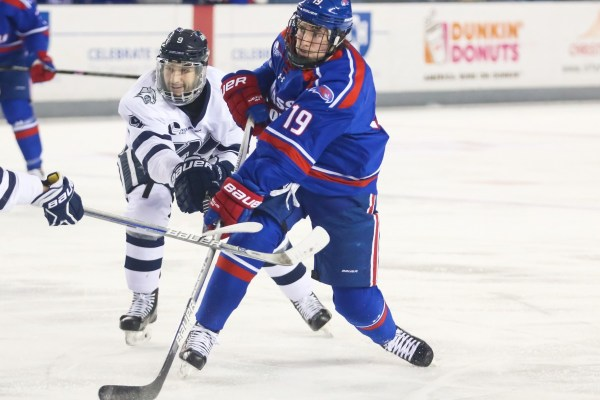 Photos: C.J. Smith scores 100th point as River Hawks hold on against UNH