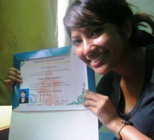Me holding my Thai massage certificate