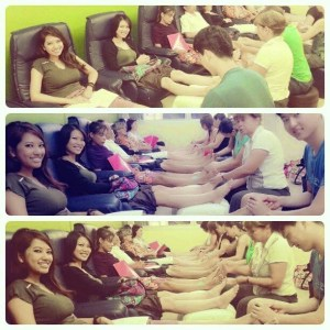 A group of people giving foot massages