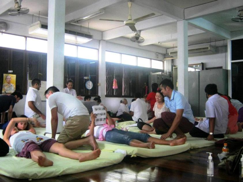 A group of people giving and receiving massages