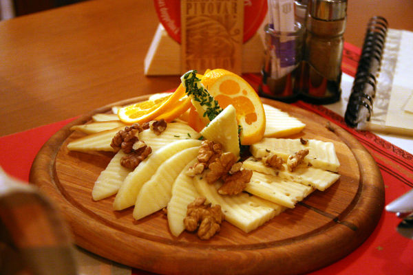Cheese on wooden board photo