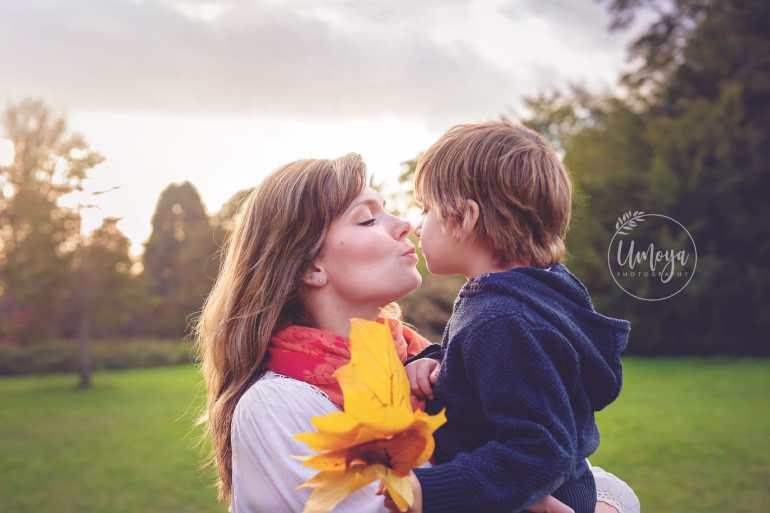 Autumn kisses between mum and son