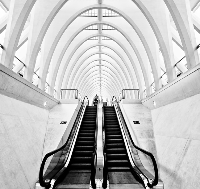 A photo of two escalators in a bright area, black and white by Andreas Wecker on Flickr