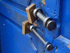 A photo of two locks on a door by Ricardo Rodriguez on Flickr