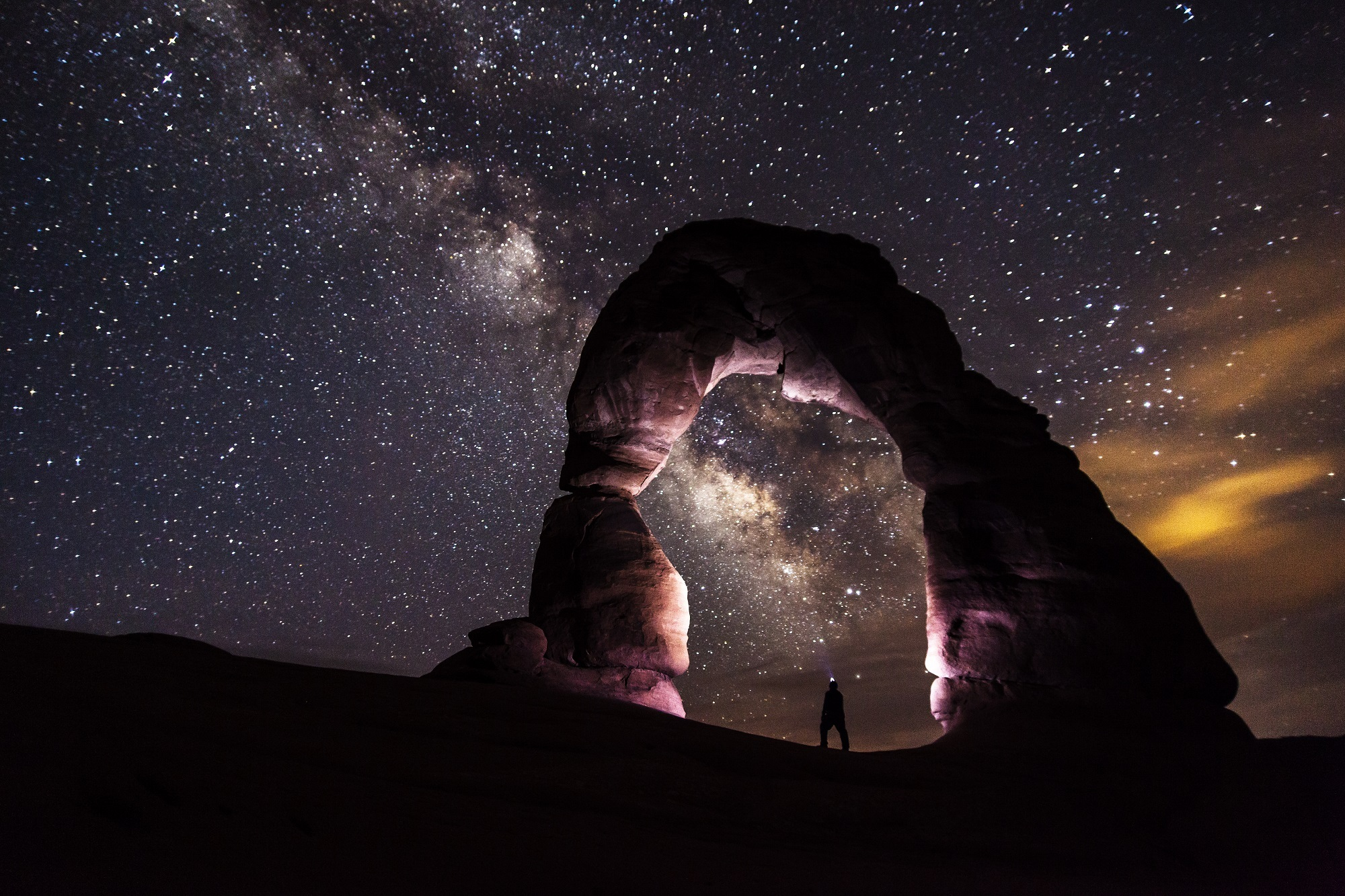A photo of Arches National Park at night, Milky Way, by skeeze on Pixabay