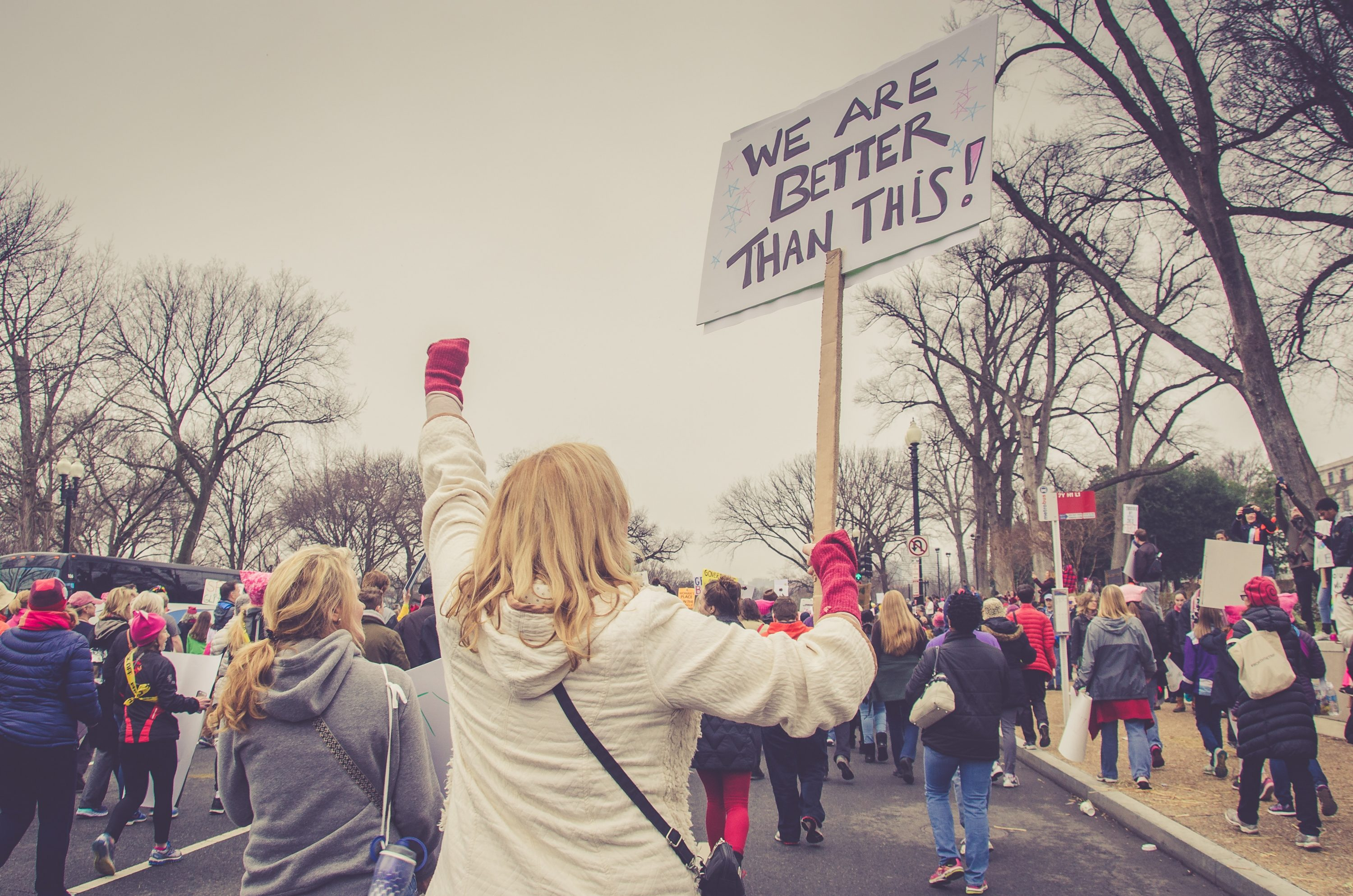 A photo of a protester by Jerry Kiesewetter on Unsplash