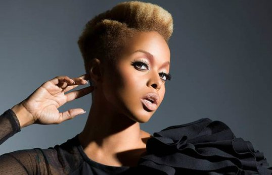 Chrisette Michele is known for her tapered short 'do. Here it seems picked out and parted. Photo via Soompi.com.