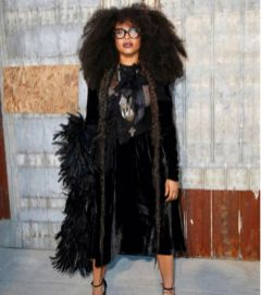 Soultress and Givenchy model, Erykah Badu sports her signature blown tresses at the designer's historic Brooklyn show.