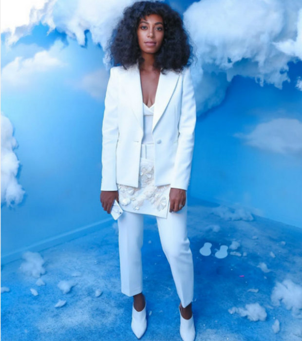 Solange Knowles keeps it simple in all white Philip Lim and textured, shoulder length locks.
