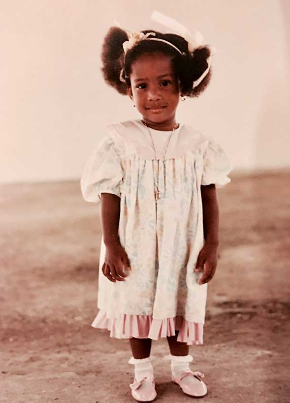 Abigail: Me with my afro puffs in Nigeria