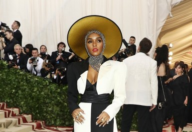 Janelle Monae was outfitted in a wide brim hat with gold lining and a chainmail hood.