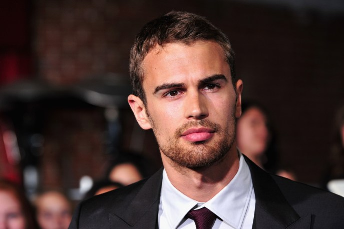 """LOS ANGELES, CA - MARCH 18: Actor Theo James arrives at the premiere of Summit Entertainment's """"Divergent"""" at the Regency Bruin Theatre on March 18, 2014 in Los Angeles, California. (Photo by Frazer Harrison/Getty Images)"""