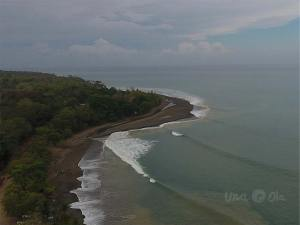 aerial view of waves at Rio Claro de Pavones