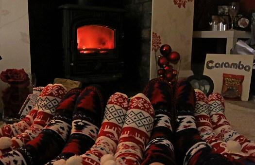 warm-woolen-slippers-and-feet-in-front-of-a-roaring-wood-burning-stove-photo-by-david-j-rodger-my-feet-are-in-the-middle