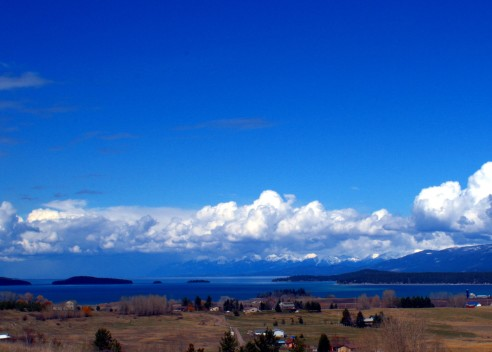 Flathead Lake is the largest natural freshwater lake west of the Mississippi River in the contiguous United States.