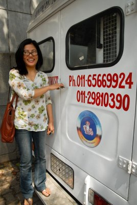 Dr. Sarungbam Yaiphabi Devi with one of the Animal India Trust mobile vet clinic vehicles.