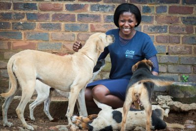 Lumka Golintete with dogs rescued by CLAW
