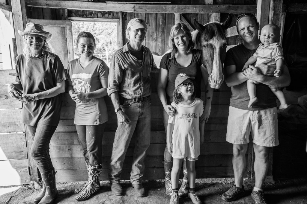 Karyn Boswell with her family and some of the staff and volunteers at Penny Lane Sanctuary.