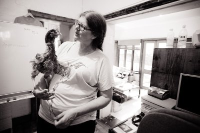 Patty Mark and a rescued hen