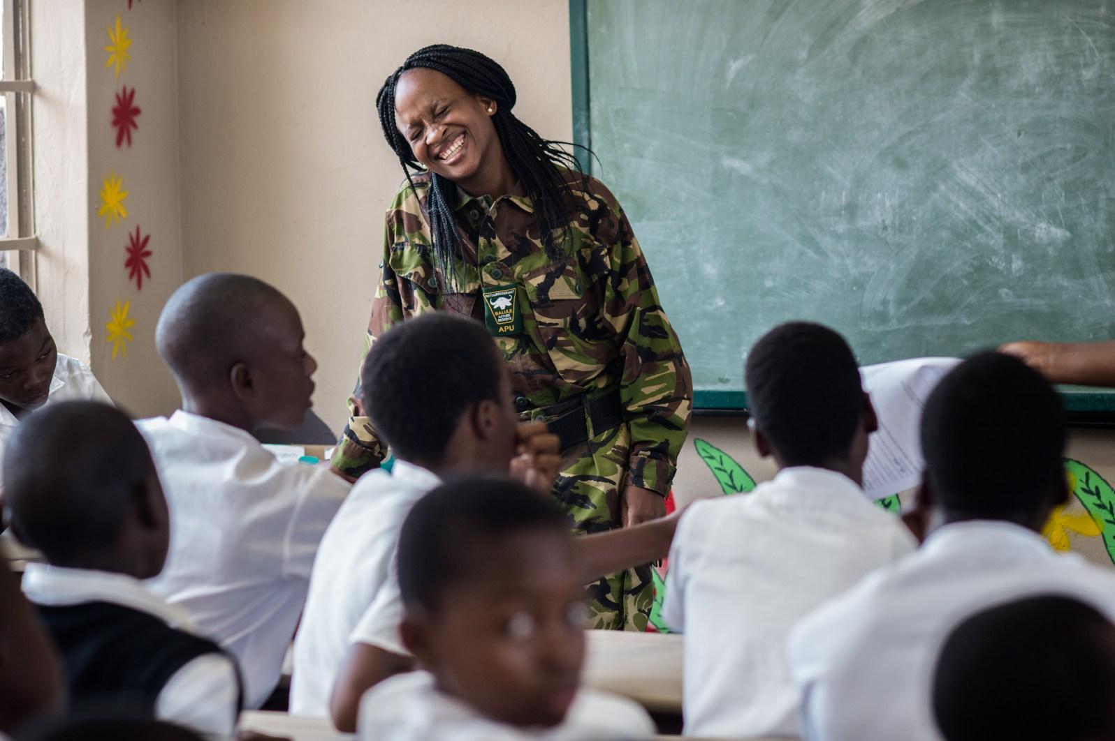 Felicia Mogahane with local students