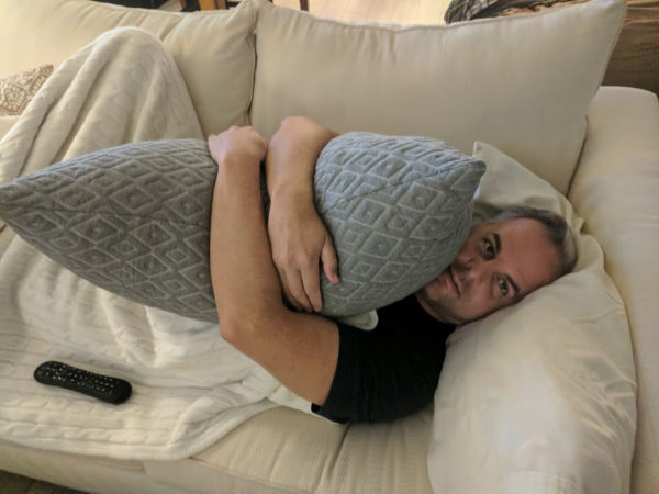 My husband hugging the Brooklyn Bedding Pillow