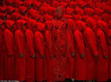 Liu-Bolin-Hiding-in-the-City-Red_2-2012