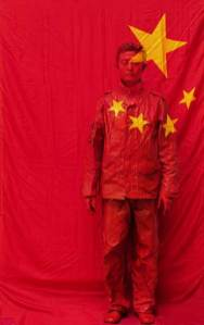 Liu-Bolin-Hiding-in-the-City_26-In-Front-of-the-Red-Flag-2006